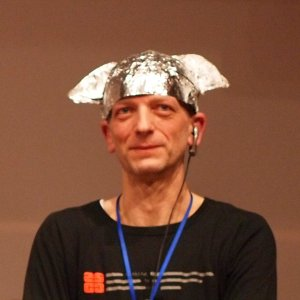 Conspiracy Blindness: a man wearing tinfoil hat