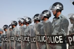 Sustainable Development: police in riot gear.