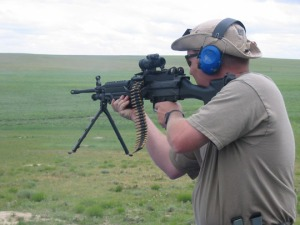 Outlawing Guns and Drugs: Dudley Brown firing semi-automatic rifle